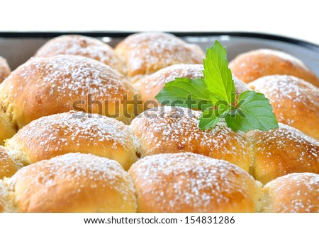 Sweet Austrian yeast pastry dumplings stuffed with apricot jam or plums and often served with vanilla sauce and coffee - stock photo