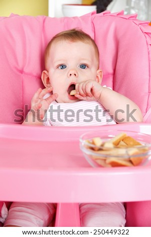 Sweet baby eating biscuit