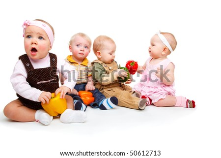 Sweet baby friends holding large peppers in hands - stock photo