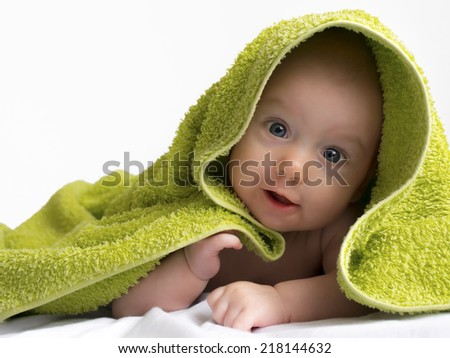 Sweet baby girl in a towel.