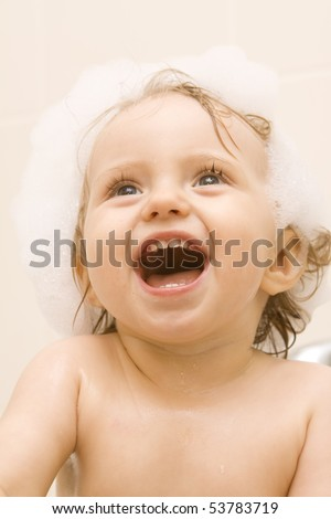 Sweet baby girl in bath - stock photo