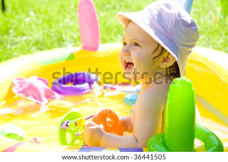 Sweet baby girl in garden - stock photo