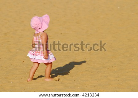 Sweet baby girl in the sandbox