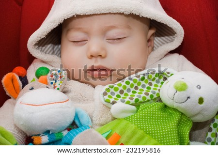 Sweet baby sleeping with stuffed rabbit and  stuffed giraffe - stock photo