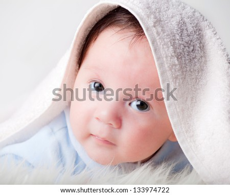 sweet baby under a cover - stock photo