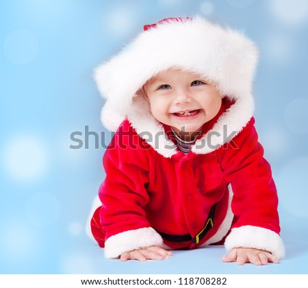 Sweet baby wearing Santa costume, over blue background with copyspace - stock photo