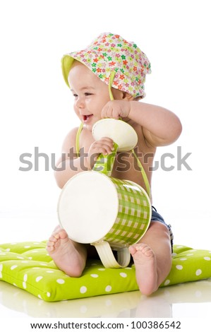 Sweet baby with watering can - stock photo