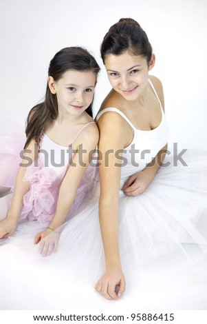 Sweet ballerina girl in a white background in a studio - stock photo