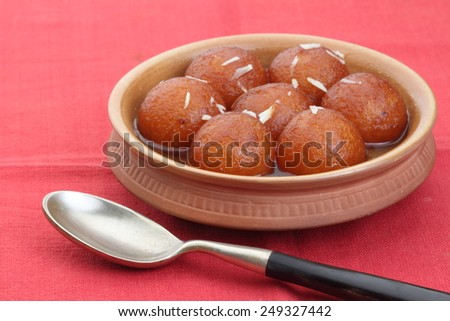 sweet balls called gulab jamun an indian sweet in a dish - stock photo