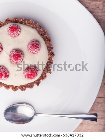 Sweet basket with cream and raspberries