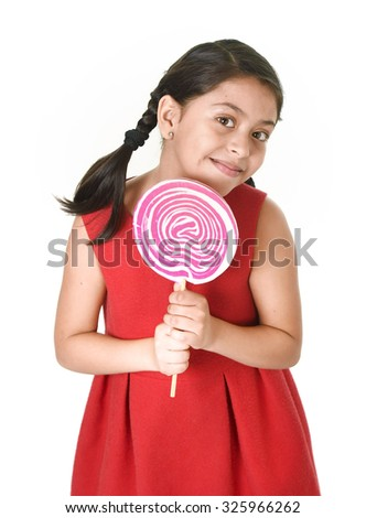 sweet beautiful latin female child holding big pink spiral lollipop looking happy  isolated on white background in funny crazy face expression and sugar addiction concept - stock photo