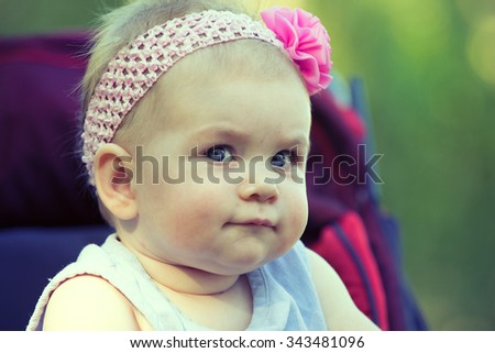 Sweet Beautiful little girl outdoors, Joyful, Happy, Excited. Closeup Headshot - stock photo