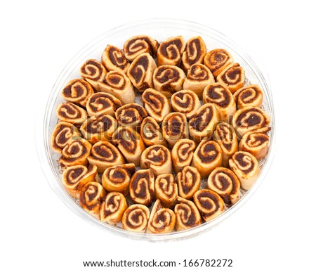Sweet biscuits in a round plastic box over white - stock photo