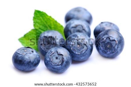 Sweet blueberries with mint  on white backgrounds.