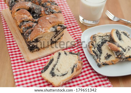 Sweet braided Bread filled with poppy seeds - stock photo