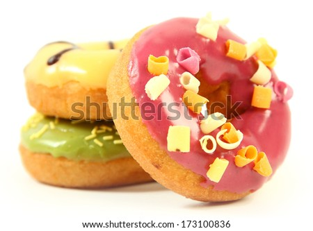 sweet bright donuts on white