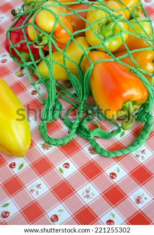 Sweet bulgarian pepper in a string market bag - stock photo