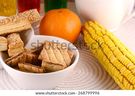 sweet cake on white plate and fruits - stock photo