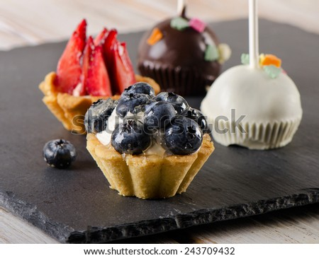 Sweet  cake pops and berry tarts. Selective focus  - stock photo