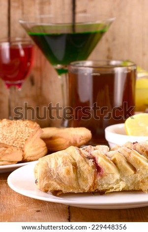 sweet cake with lemon and banana with wine - stock photo