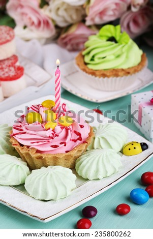 Sweet cakes on birthday table close-up - stock photo