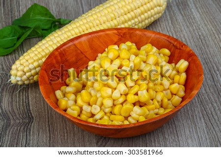 Sweet canned fresh corn on the wood background
