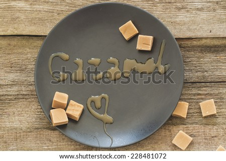 Sweet caramel candy on a dish - stock photo