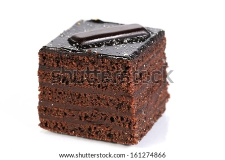 sweet chocolate cake against white background