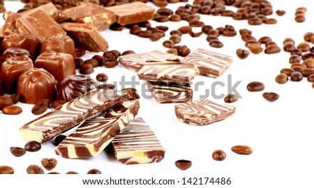 sweet chocolate candies and coffee beans isolated on white background - stock photo