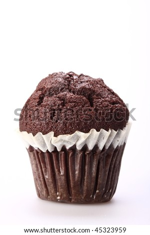 Sweet chocolate muffin on white background