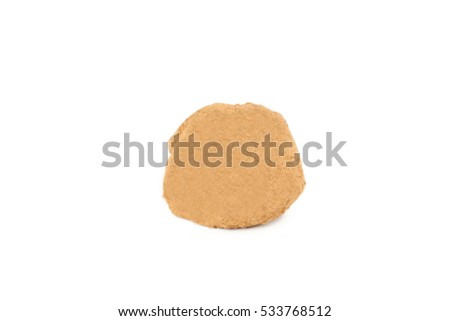 Sweet chocolate truffle isolated on a white