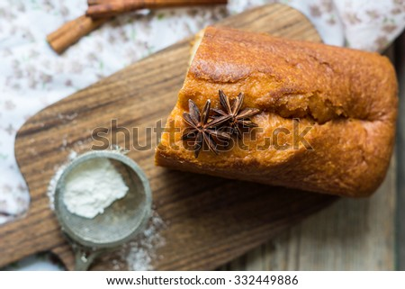 Sweet christmas cake on wooden board - stock photo