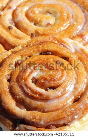 Sweet cinnamon raisin buns - stock photo