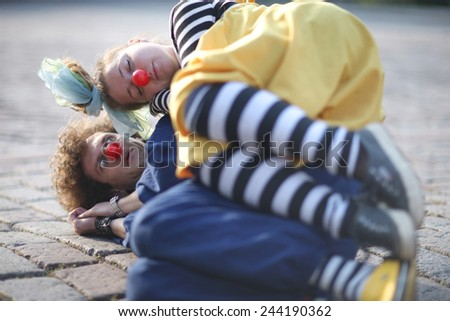 Sweet clown couple; street theater, pantomime - stock photo
