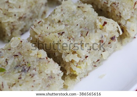 sweet coconut burfi, indian popular sweet made up of coconut, milk and sugar - stock photo
