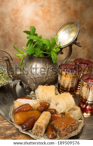 Sweet cookies and dates on a Moroccan tea tray - stock photo