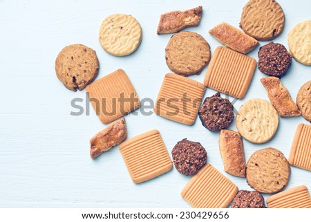 sweet cookies on blue table - stock photo