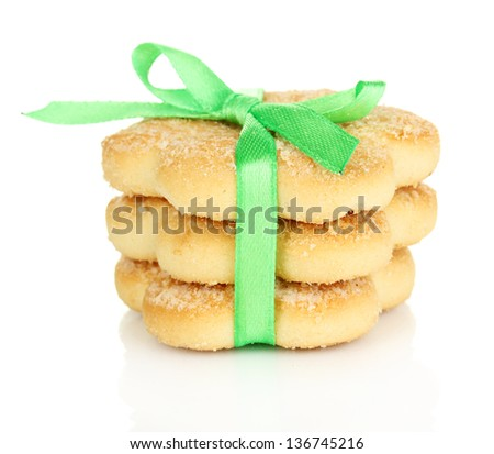Sweet cookies tied with green ribbon isolated on white