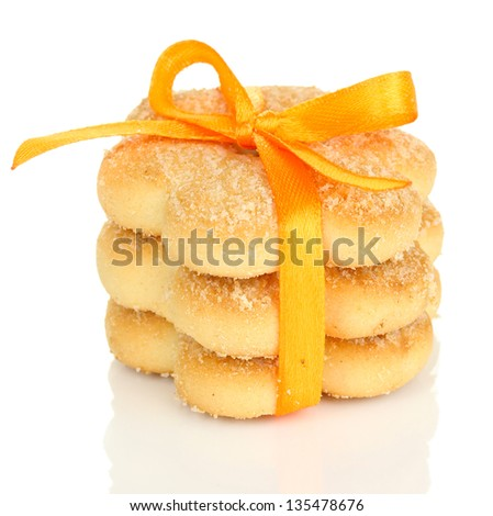 Sweet cookies tied with orange ribbon isolated on white - stock photo