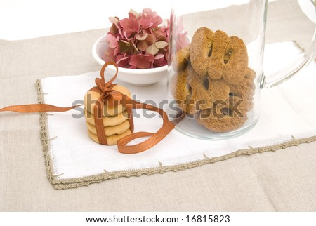 Sweet cookies with flowers background