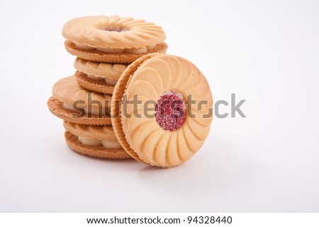 Sweet cookies with jam isolated on white
