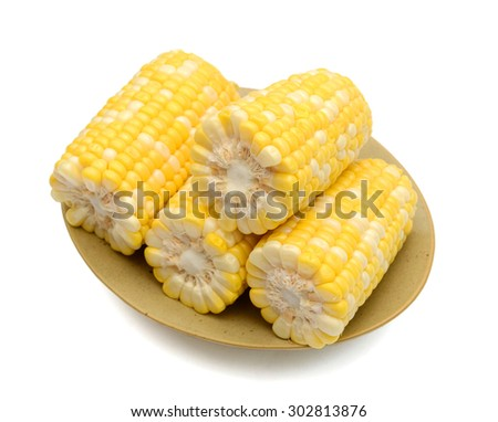 sweet corns on plate isolated on white  - stock photo
