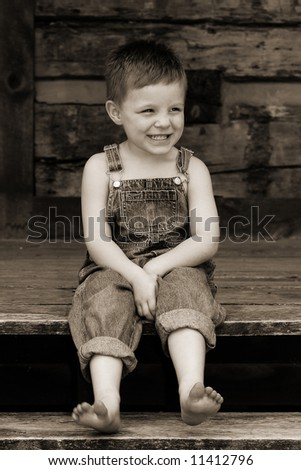 Sweet country boy gets tickled - stock photo