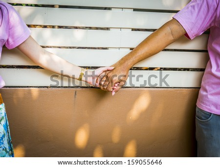 Sweet couple hold the hands - stock photo