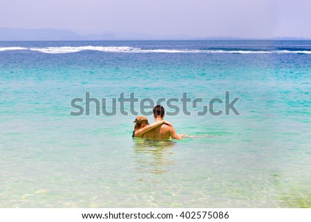 Sweet couple on the beach - stock photo