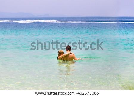 Sweet couple on the beach - stock photo