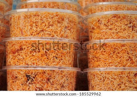 Sweet crispy noodles packed in plastic box. - stock photo