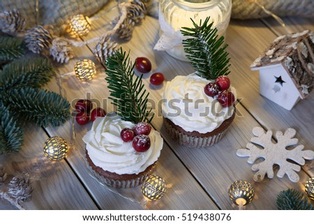 sweet cupcake on wooden background