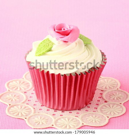 Sweet Cupcake with flower decoration in pink