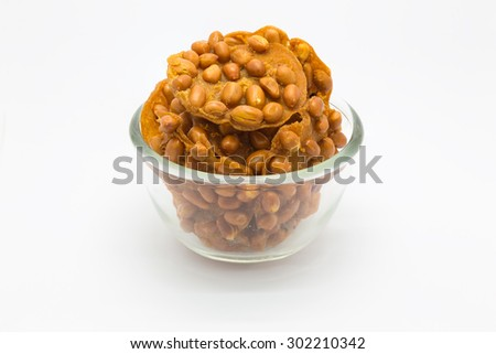 Sweet deep fried peanut cookie on white background, in a glass bowl - stock photo